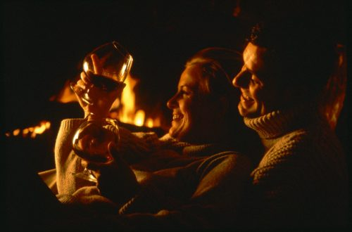 by the fireplace Winter Holidays: What To Do If You Don't Ski - EAT LOVE SAVOR International luxury lifestyle magazine and bookazines