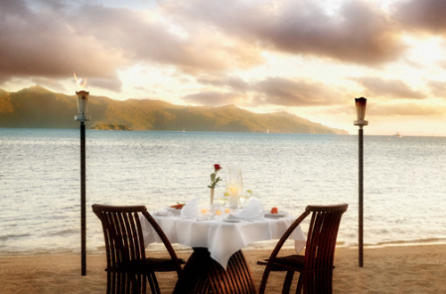romantic setting table for two on beach