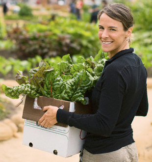 woman holding box of vegetables Discover: Community Farms - EAT LOVE SAVOR International luxury lifestyle magazine and bookazines