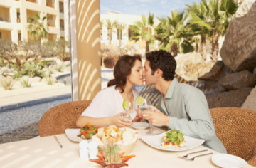 Couple kiss on vacation Top 7 Luxury Summer Destinations - EAT LOVE SAVOR International luxury lifestyle magazine and bookazines
