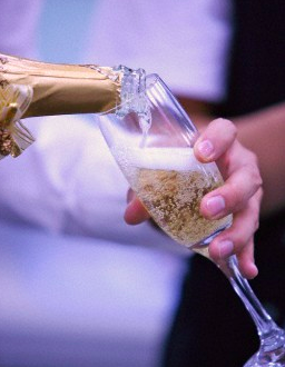 champagne being poured into a glass A Little About Champagne: Bottled Icons of Luxury EAT LOVE SAVOR International luxury lifestyle magazine and bookazines