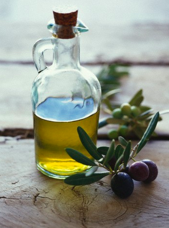 Bottle of olive oil and olives DISCOVER: OLIVES: Mythology, History and Olive Groves EAT LOVE SAVOR International luxury lifestyle magazine and bookazines