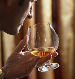 man and snifter Cognac: The History and the Art of Enjoying Cognac EAT LOVE SAVOR International luxury lifestyle magazine and bookazines