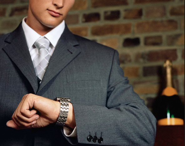 man looking at watch Tips for Women on Selecting Fine Watches for Men - EAT LOVE SAVOR International luxury lifestyle magazine and bookazines