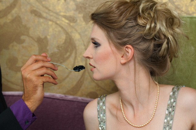 Man feeding girlfriend caviar