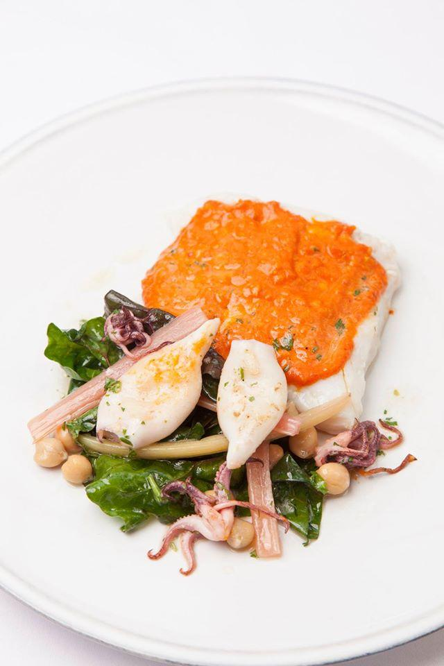 Poached hake, grilled squid, flower sprouts and Romesco
