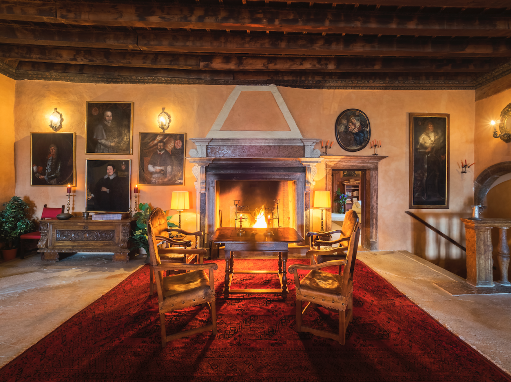 Castel Valer by the fireplace - eat love savor luxury lifestyle magazine