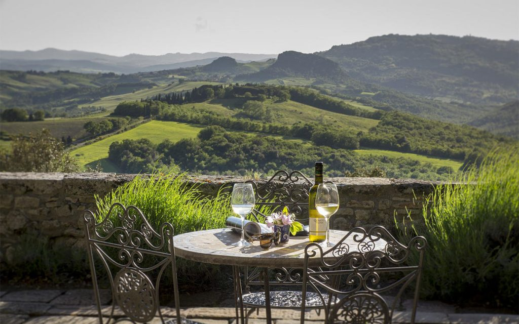 outdoor dining borgo pignano - eat love savor - luxury lifestyle magazine
