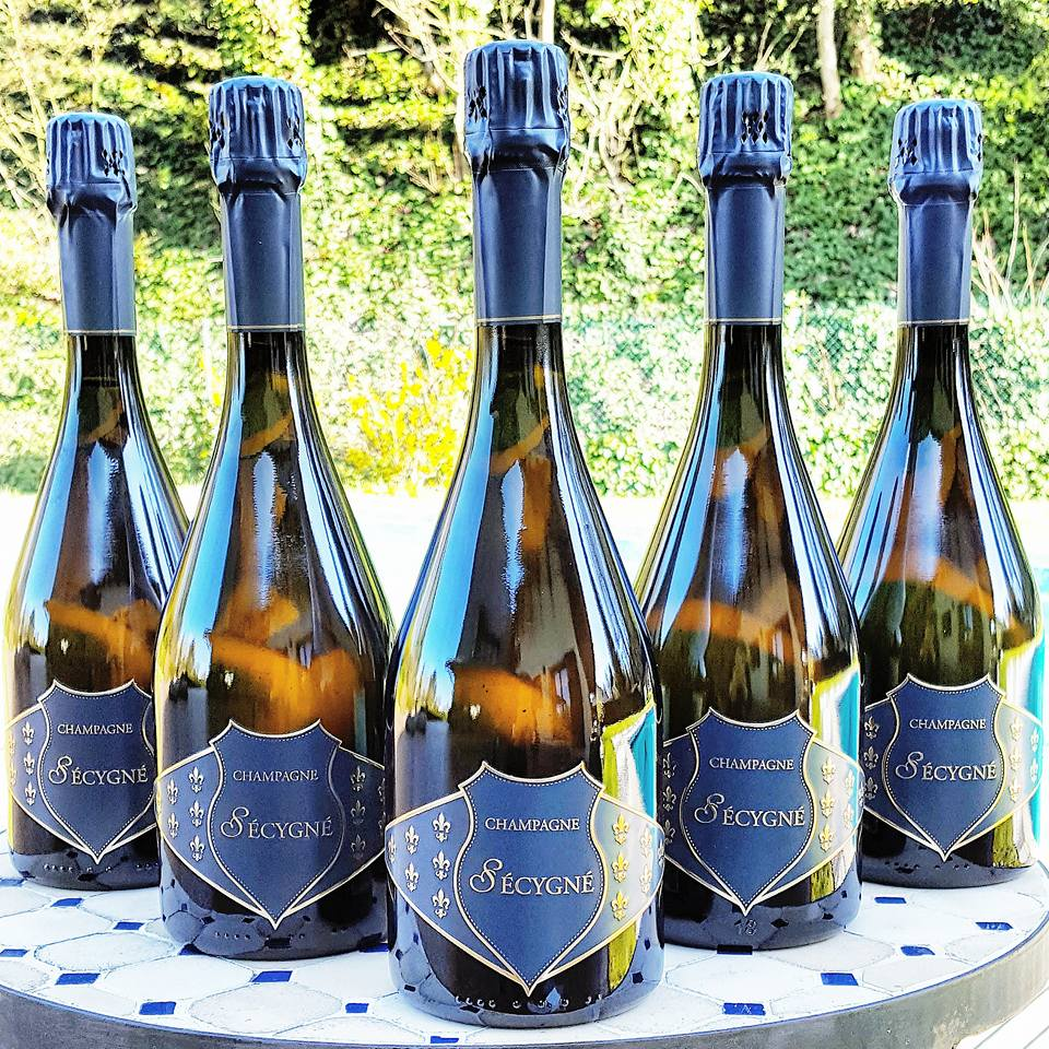 champagne secygne bottles Must-Try Champagnes, Delicious Pairings and Beautiful Flutes - EAT LOVE SAVOR International luxury lifestyle magazine and bookazines