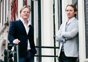 Marijn Smit and Merijn de Waard of SuperYacht Gallery All bow for the SuperYacht Gallery at Saatchi London - EAT LOVE SAVOR International luxury lifestyle magazine and bookazines