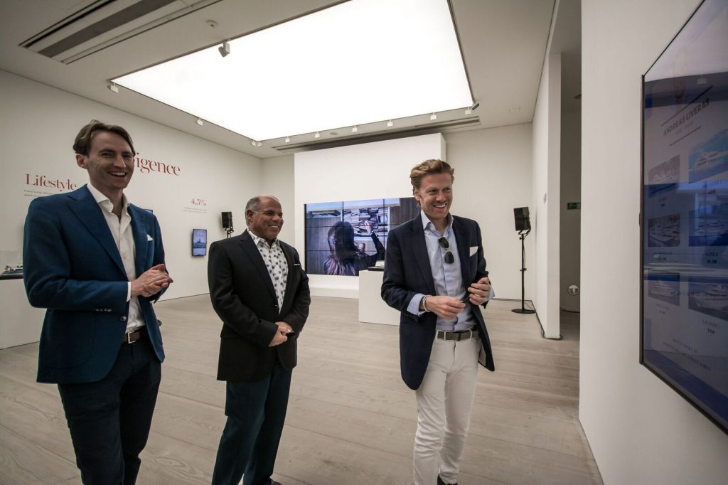 superyacht gallery men looking at art All bow for the SuperYacht Gallery at Saatchi London - EAT LOVE SAVOR International luxury lifestyle magazine and bookazines